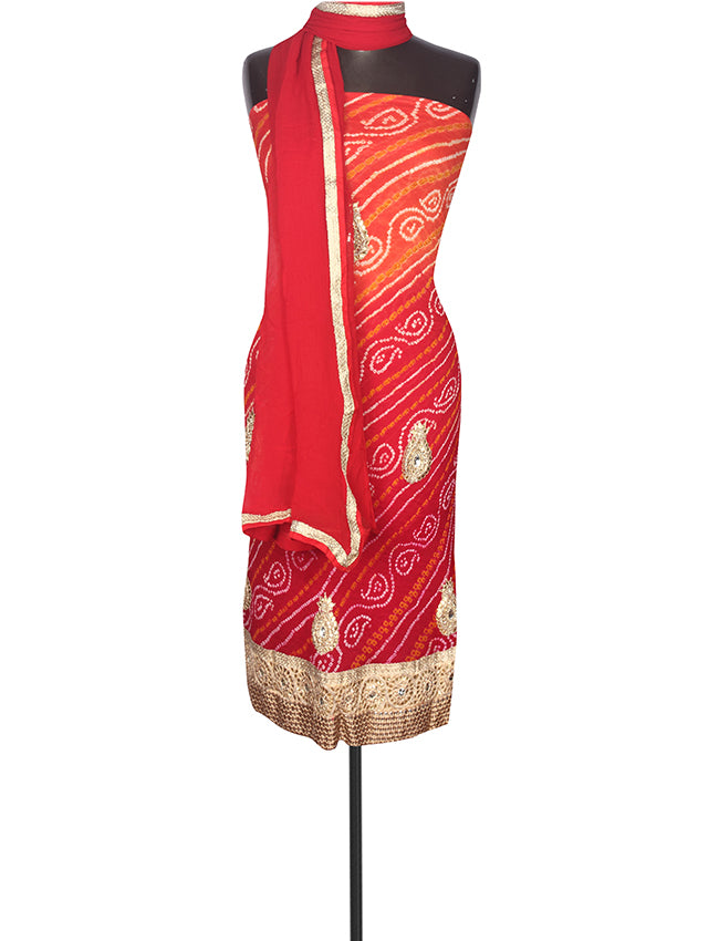 Red orange bandhani unstitched suit with zari zardosi and gotta patti