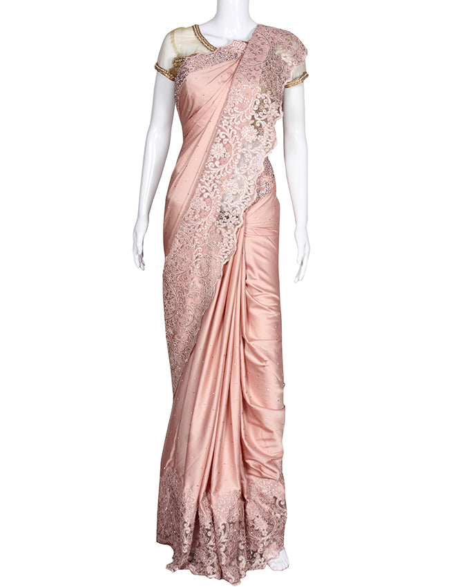 Peach party wear saree with pearl diamante and cutdana work