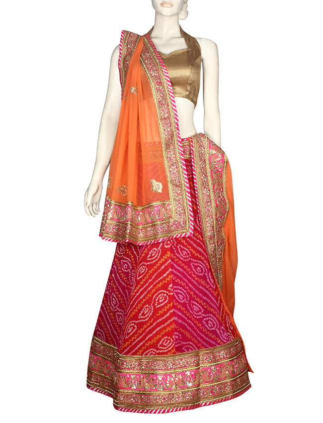 Red pink shaded bandhani unstitched lehenga with zari embroidery handwork and gotta patti