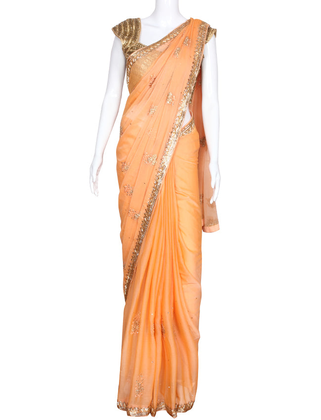 Peach party wear saree with cutdana kundan resham and zari embroidery