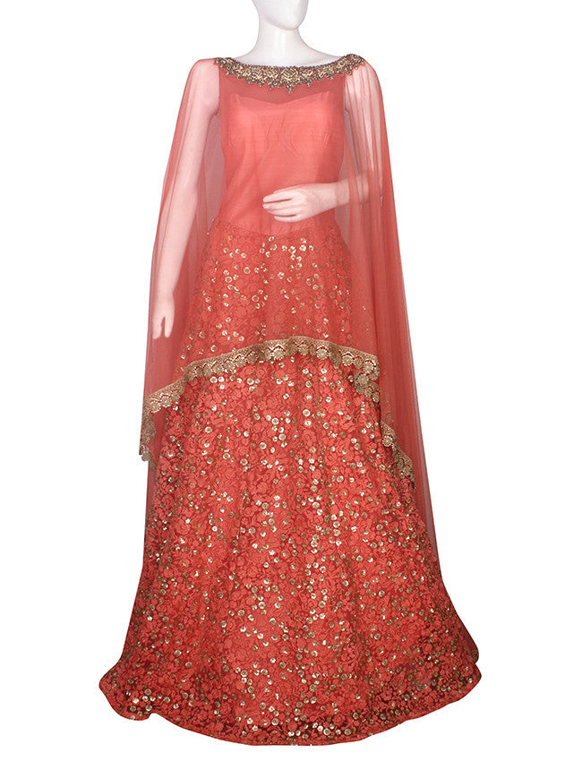 Carrot peach cape gown with zardosi work