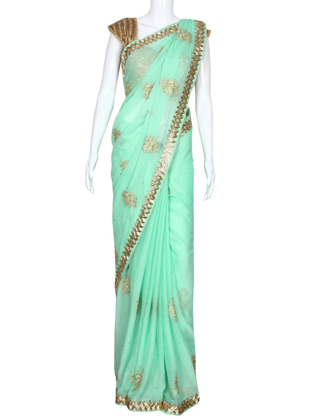 Pista green party wear saree with cutdana kundan and zari embroidery
