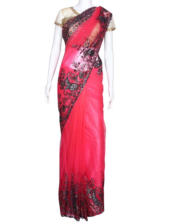 Neon pink party wear saree with sequins cutdana and zari embroidery