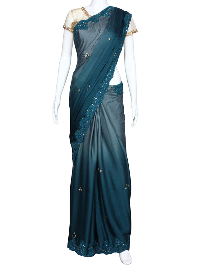 Shaded dusty blue saree with thread cording and handwork