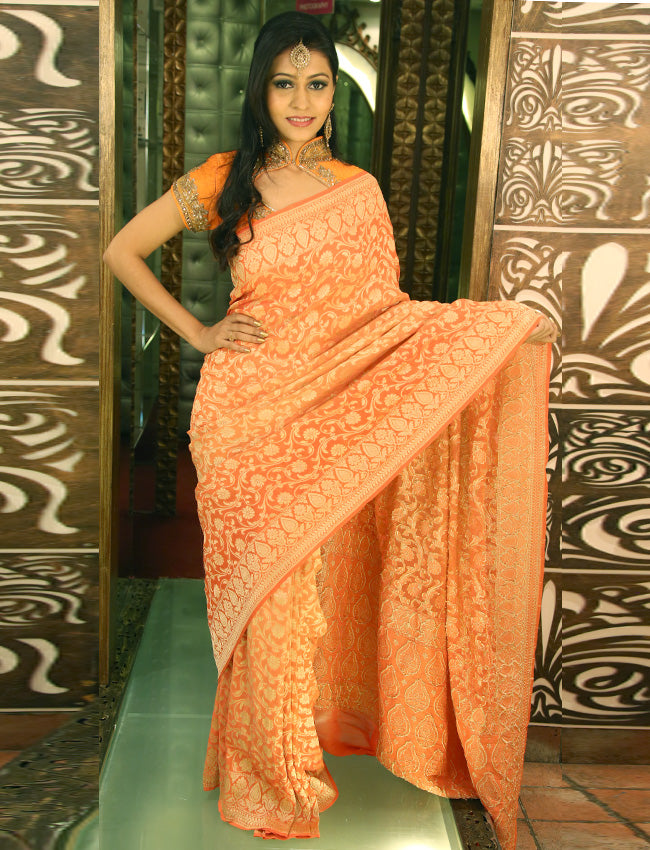 Orange party wear saree with self weaving