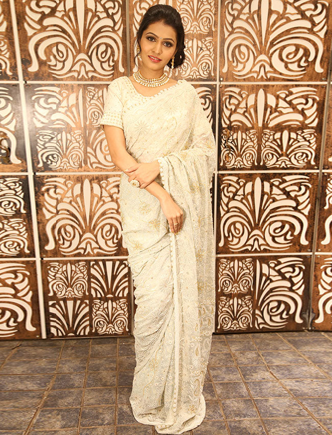 White glittery party wear saree with pearl and thread embroidery