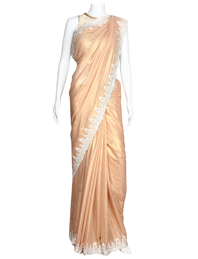 Peach party wear saree with diamante and beads work