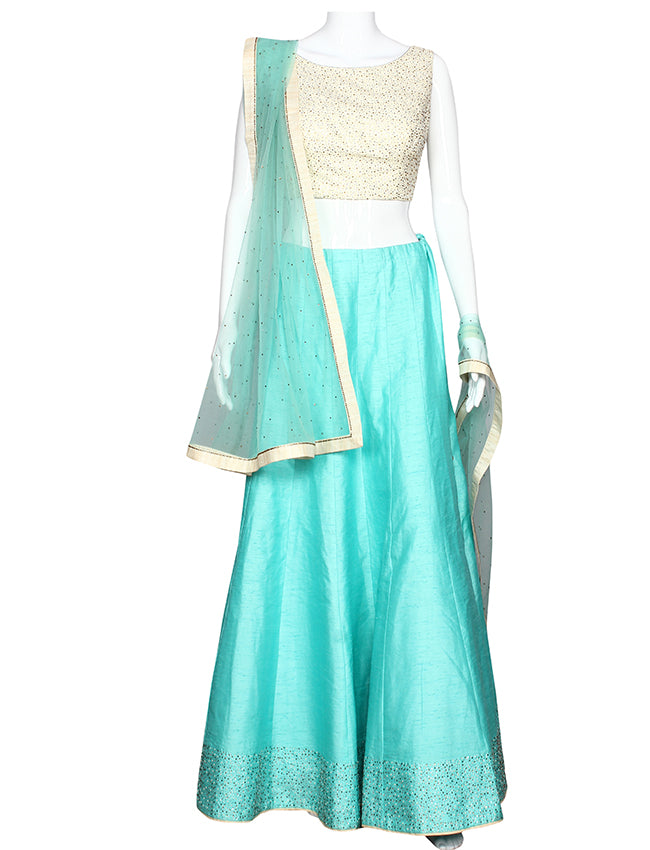 Turquoise party wear lehenga with kundan scattered