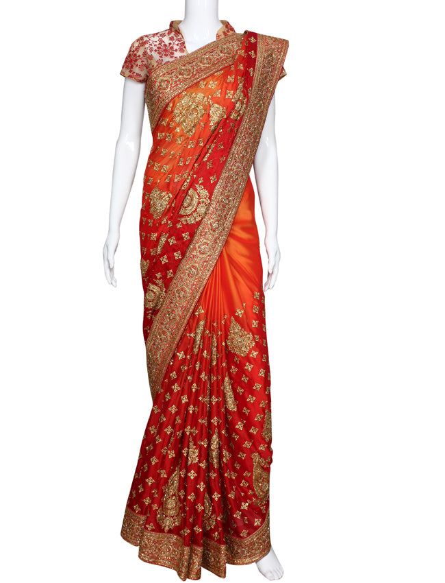 Red orange shaded saree with kundan cutdana beads and zari embroidery