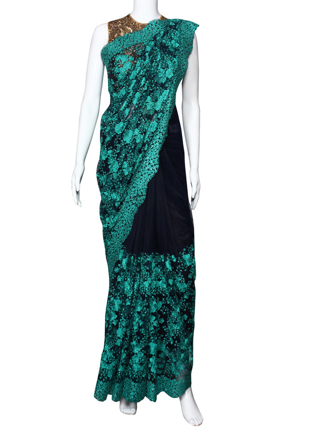 Navy blue party wear saree with machine embroidery and kundan work