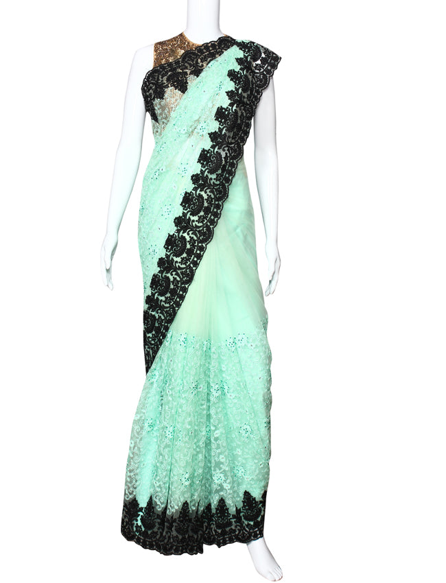 Mint party wear saree with kundan pearl and machine embroidery