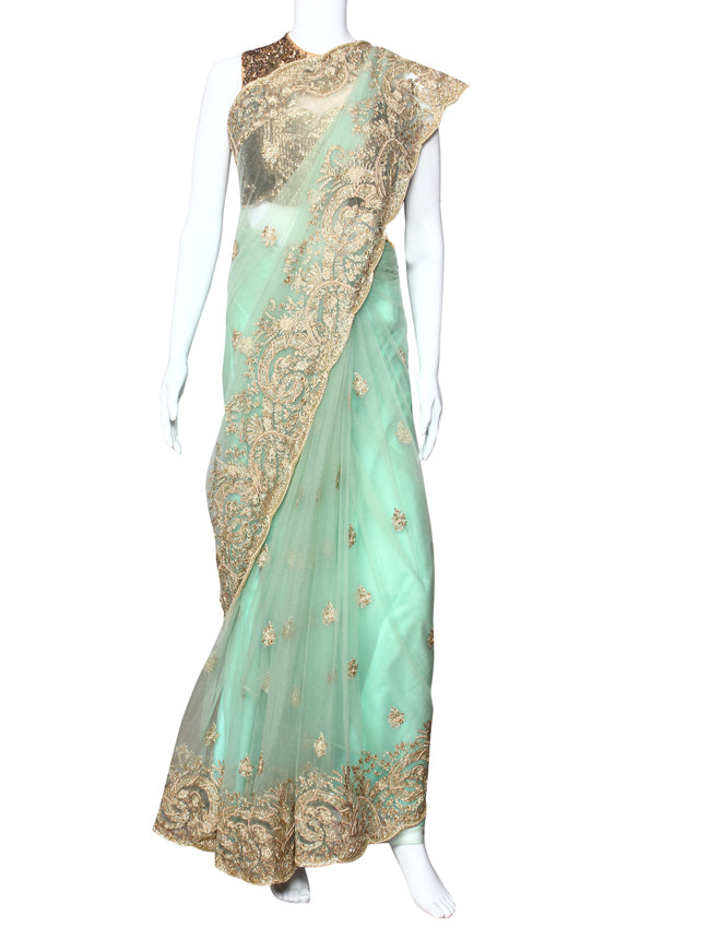 Dusty pista green party wear saree with cutdana pearl and zari embroidery