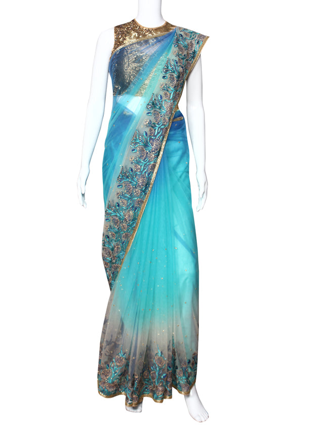 Shaded blue party wear saree with kundan cutdana and machine embroidery