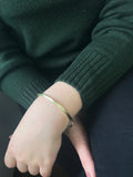 additional image of model wearing Sheila Fajl Pyramid Bangle Bracelet in Gold Plated