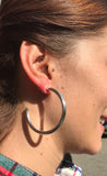 model wearing Sheila Fajl Smaller Favorite Hoop Earrings in Polished Silver