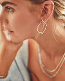 Model Wearing Kendra Scott Miku Abstract Hoop Earrings in Gold Plated
