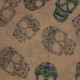 detail fabric swatch of Blue Pacific Frida Cashmere and Silk Scarf with Sugar Skulls in Taupe