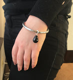 model wearing Simon Sebbag Charm Bangle Bracelet in Onyx and Silver