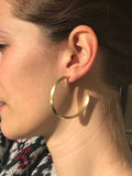 Model Wearing Sheila Fajl Celine Pyramid Hoop Earrings in Gold