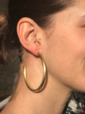 Model Wearing Sheila Fajl Everybody's Favorite Hoop Earrings in Gold