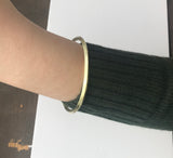 model wearing Sheila Fajl Pyramid Bangle Bracelet in Gold Plated