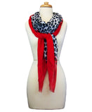 Mannequin Wearing Blue Pacific Animal Print Cashmere and Silk Scarf in Bright Red and Snow Grey