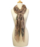 mannequin wearing Blue Pacific Frida Cashmere and Silk Scarf with Sugar Skulls in Taupe