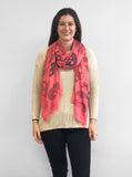Model Wearing Blue Pacific Frida Cashmere and Silk Scarf with Skulls in Sugar Coral