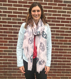 model wearing Blue Pacific Frida Cashmere and Silk Scarf with Sugar Skulls in Pink
