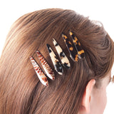 model wearing Ficcare Mini Maximas Hair Clips