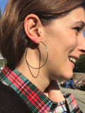 model wearing Sheila Fajl Lisa Featherweight Hoop Earrings in Polished Silver