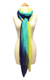 Mannequin Wearing Blue Pacific Dream Cashmere and Silk Scarf in Navy Bright Turquoise Yellow