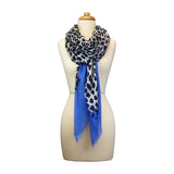 Mannequin Wearing Blue Pacific Animal Print Cashmere and Silk Scarf in Denim and Snow