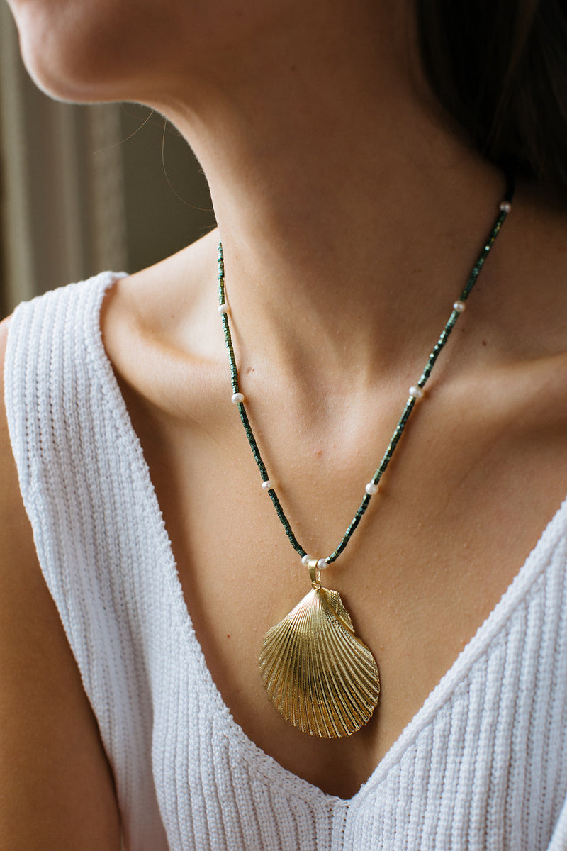 Hart gold shell mermaid necklace on model