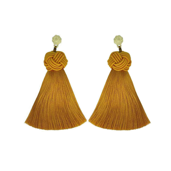 Hart tumeric topknot tassel earrings on white background