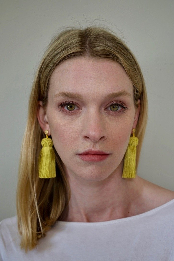 Hart chartreuse topknots tassel earrings on model