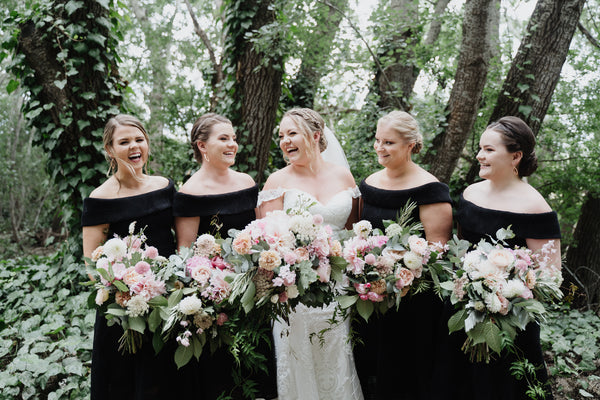Her bridesmaids wearing our Alex Dress in Black. Photo by All My Wednesdays.