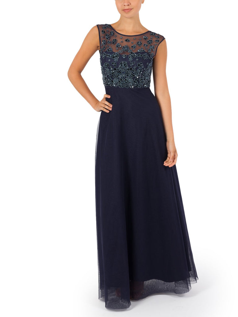 The Delfina Hand Beaded Gown Shaped With Sparkling Sequins Illuminating The Bodice Of The Navy Tulle Gown