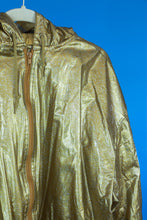 1990s gold raincoat by Wippette