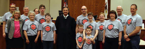 Everyone wearing personalized matching shirts on Adoption Day at the courthouse.