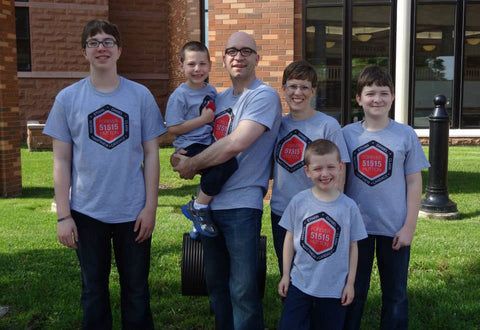 Our family wearing personalized matching shirts on Adoption Day.