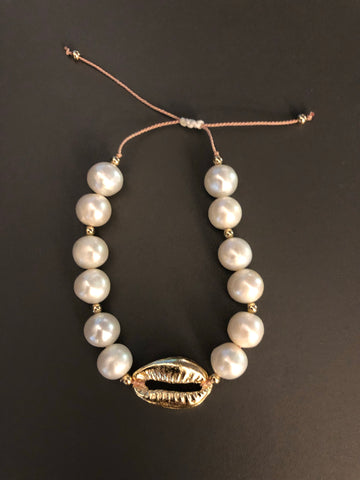 Pearl with gold shell on adjustable silk