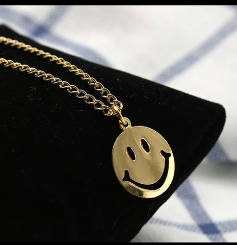 Gold smiley necklace