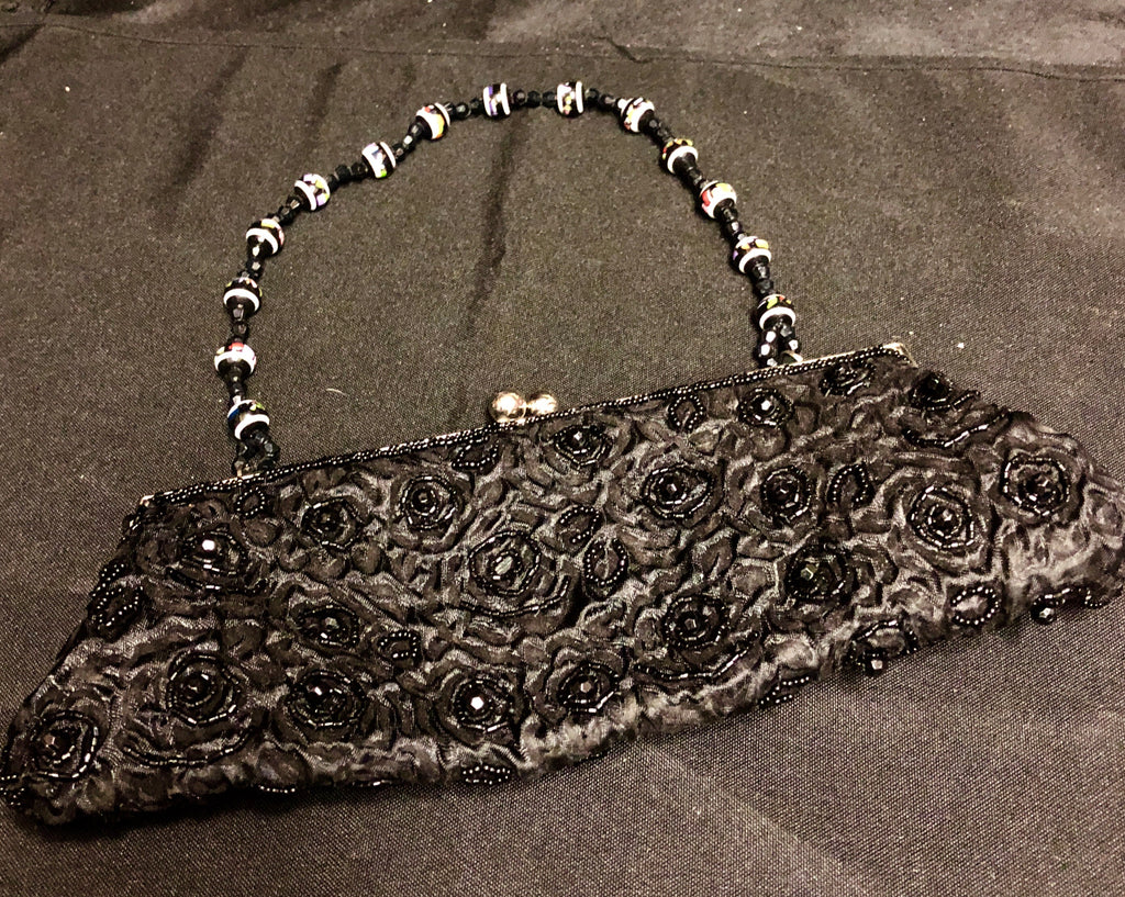 Sequin clutch with beaded strap