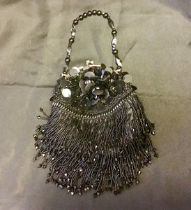 Black round sequin handbag