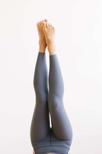 Legs in yoga pose wearing Meditation Exercise pants in Grey