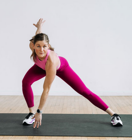 woman wearing pink sportswear exercising