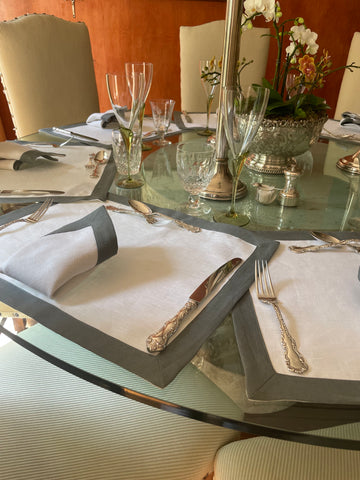 Place setting grey contrast border with traditional silverware