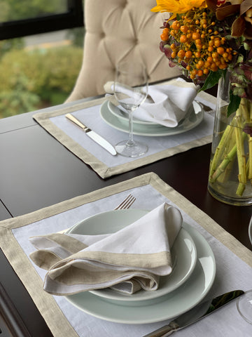 Relaxed place setting with beige contrast border table setting