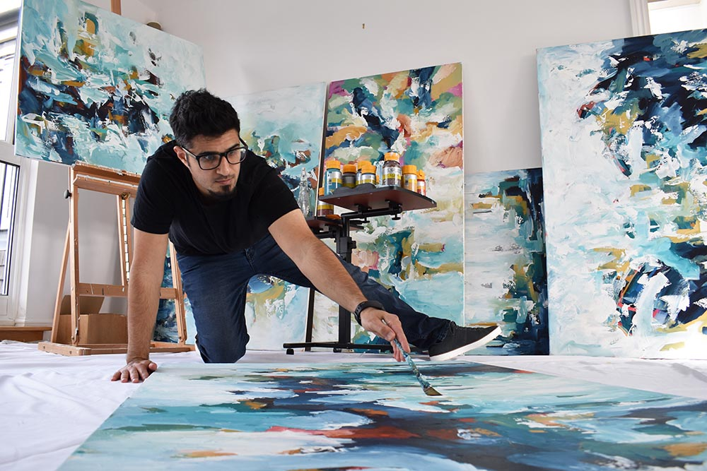 Artist Omar Obaid working in his London art studio